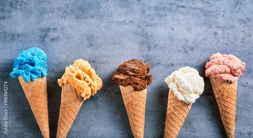 Fotografie, Obraz  Assorted ice cream flavors in cones in a banner