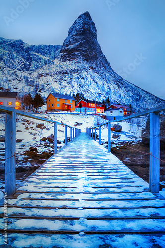 Blue hour. Beautiful winter landscape with traditional Norwegian fishing huts rorbu