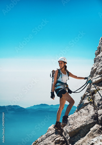 Fit attractive woman mountaineer