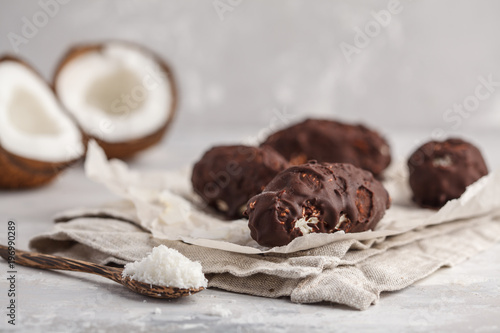 Raw homemade vegan chocolate coconut candy bounty, white background Wallpaper Mural