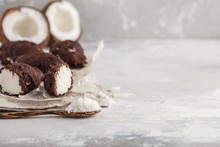 Raw Homemade Vegan Chocolate Coconut Candy Bounty, White Background, Copy Space. Healthy Vegan Food Concept.