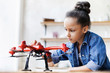 canvas print picture - Young cute girl holding quadcopter. Child playing with drone. Education, children, technology, science, future and people concept