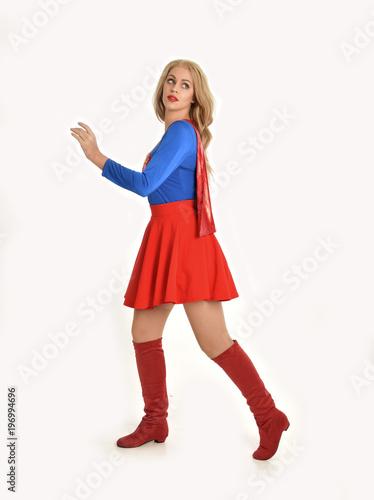 фотография full length portrait of pretty girl wearing super hero costume, standing pose, isolated on white studio background
