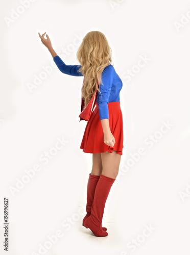 Fotografía full length portrait of pretty girl wearing super hero costume, standing pose, isolated on white studio background