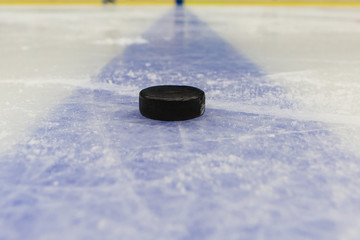 blue line with puck on ice hockey rink