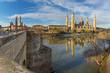 Zaragoza - The bridge Puente de Piedra and Basilica del Pilar with the riverside of Ebro river in the morning light.