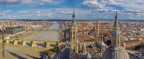 Zaragoza - The cityscape from cathedral Basilica del Pilar tower with the Puente de Piedra bridge,