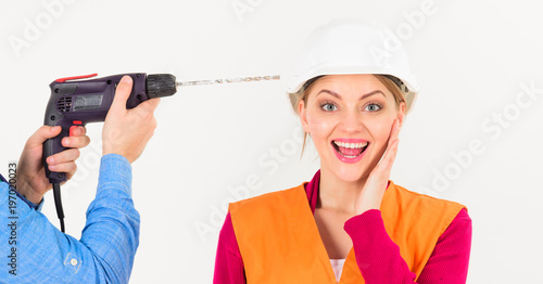 Photo Male hands with drill drills head of woman, white background.