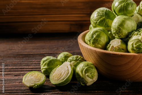 Brussels sprouts on a rustic wooden background
