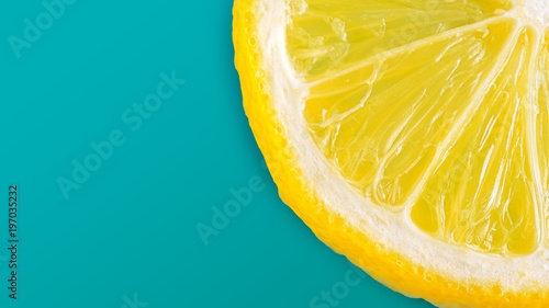 Photo  The half slice of the fresh lemon on cyan pastal color background