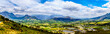 canvas print picture - Panorama view of the Franschhoek Valley in the Western Cape of South Africa with its many vineyards in the Cape Winelands, surrounded by the Drakenstein mountain range, as seen from Franschhoek Pass