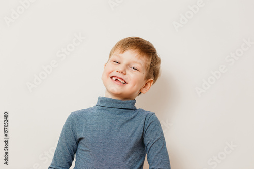 cheerful toothless boy six years old in striped turtleneck on white background Poster