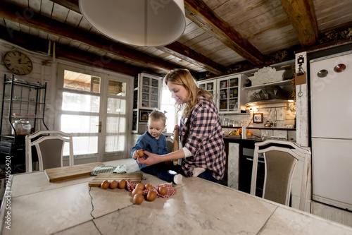 Fototapety, obrazy: Pregnant woman and little daughter in the rustic kitchen