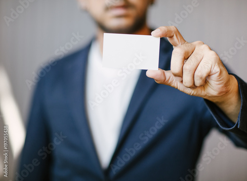 Man holding white business cardman wearing blue shirt and showing man holding white business cardman wearing blue shirt and showing blank white business card colourmoves