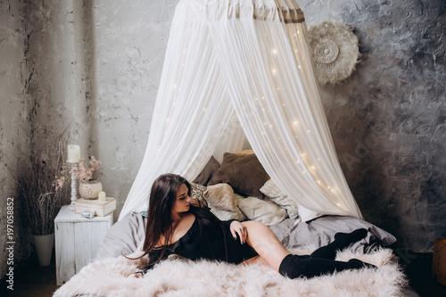 Fotografie, Obraz  Young girl in black body
