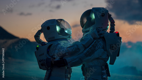Fotografia Two Astronauts in Space Suits Hugging on Alien Planet, Exploration of the the Planet's Surface