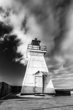 Rugged White Lighthouse Standi...