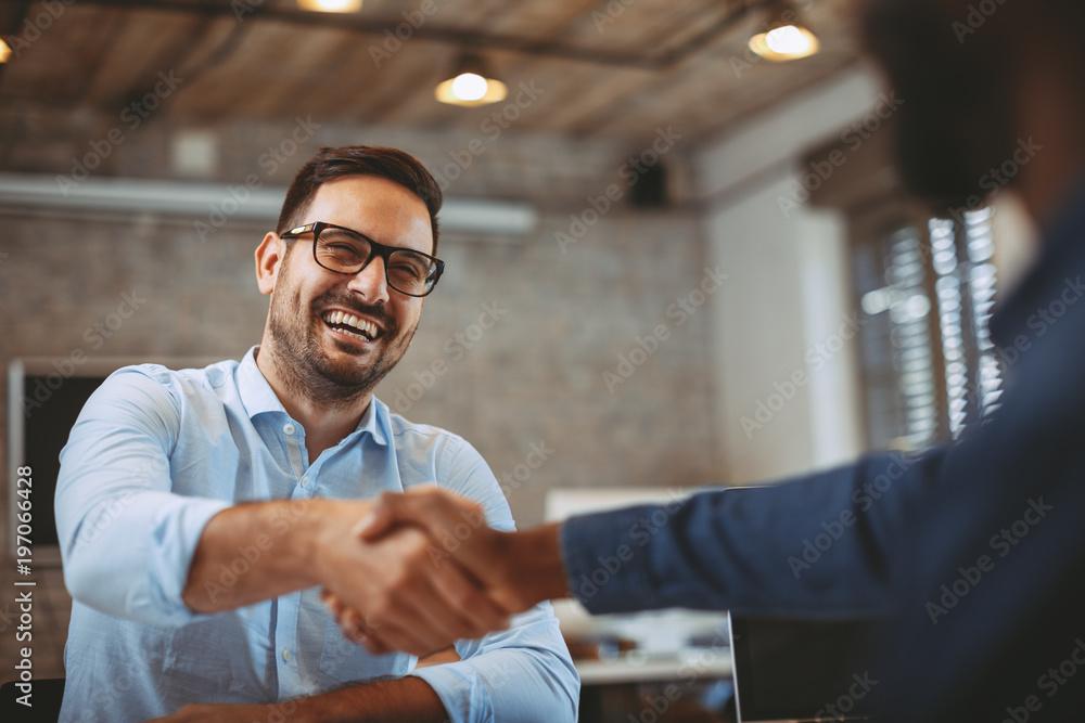 Fototapeta Close up of handshake in the office