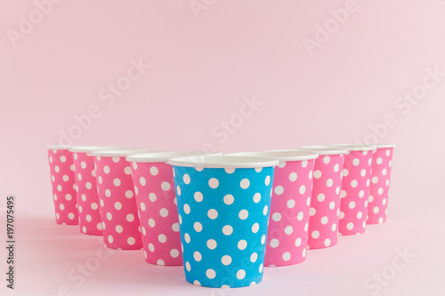 Foto op Aluminium Retro sign Paper cups with polka dots isolated on pastel rose background minimalistic drink concept