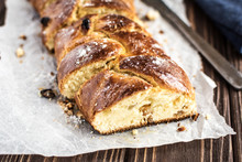 Homemade Braided Sweet Bread With Raisins On A Wooden Background