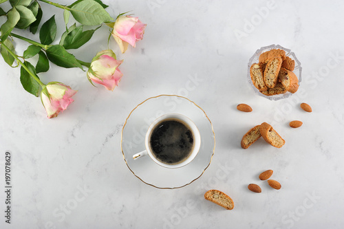 A cup of coffee and a popular Italian biscotti cookie with almonds Fototapeta