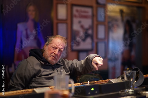 Elderly Bar Patron Having An Alcoholic Drink Asking For Another Drink Poster