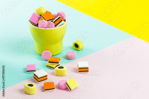 fashion food candy: liquorice allsorts in a yellow cup Wallpaper Mural