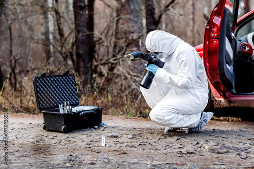 expert collecting evidence at the crime scene Fototapeta