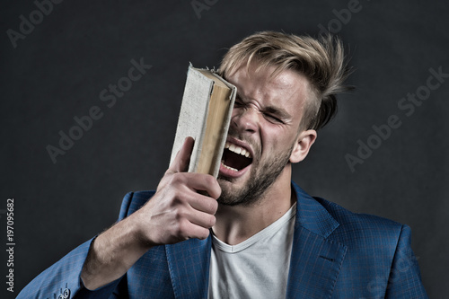 Angry businessman shout with book, knowledge Poster