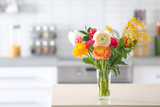 Vase with beautiful ranunculus flowers indoors