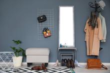 Stylish Hallway Interior With Large Mirror And Coat Rack