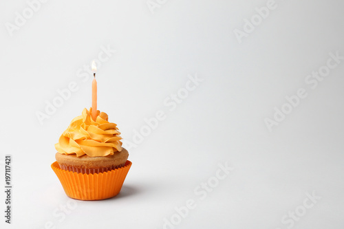 Birthday cupcake with candle on white background Canvas Print