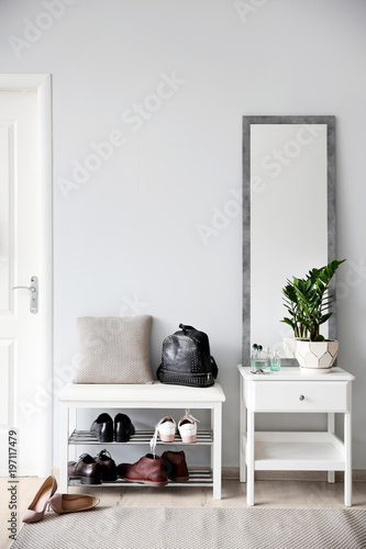 Stylish hallway interior with large mirror