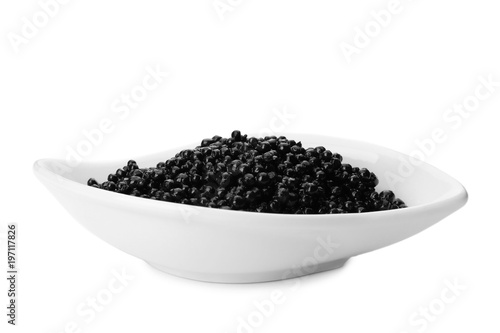 Ceramic bowl with black caviar on white background