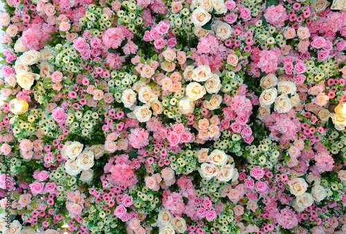 Fotobehang Bloemen Beautiful pink, peach, yellow and cream colored roses, esters, daisies and hydrangea wall paper. Wedding background.