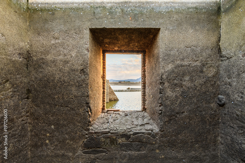 landscape through a window of a few ruins