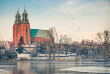 Gniezno, Poland; Evening View To The Gothic Cathedral Upon The Frozen Lake. Winter.
