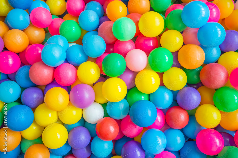 Fototapeta Top view of many colorful balls in ball pool at indoors playground