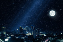 Glowing City With Bright Moon And Many Stars In Sky