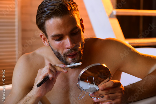 Fotografie, Obraz  Macho with shaving soap on beard hair look in mirror