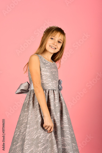 7819acd11dfb Fashion model on pink background, beauty. Fashion and beauty, little  princess. Little girl in fashionable dress, prom.