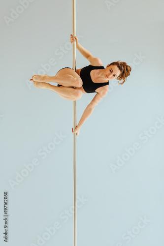 Valokuvatapetti Beautiful pole dancer performing in the studio