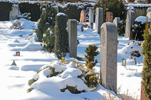 Graveyard On A Sunny Winter Day With Snow