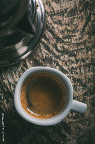 Coffee cup on rustic wooden table