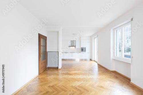 Fototapeta Kitchen in newly renovated open space with wooden floors obraz na płótnie
