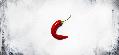 Staande foto Hot chili peppers Red hot chili pepper on a gray background, minimalistic style, top view