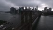 Aerial wide panoramic shot of the mighty and old Brooklyn Bridge with the modern Manhattan in front