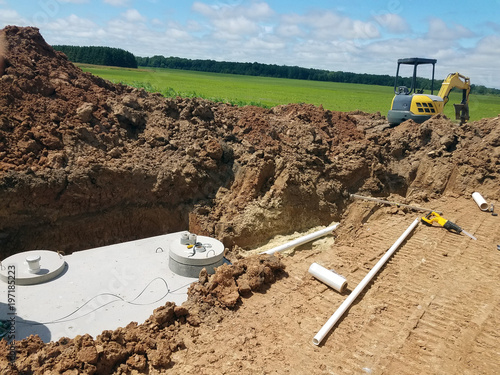 Photo  Concrete Septic holding tanks being buried