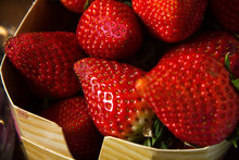 There Are Many Red Macro Strawberries In Wicker Basket