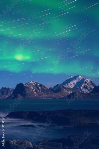 Northern lights, Aurora borealis with star trails over the rocky mountains, scenic night landscape, Lofoten Islands, Norway Poster